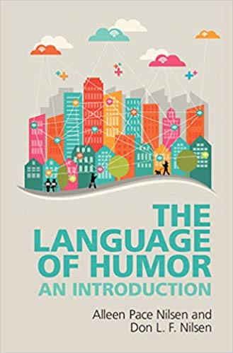 """Cover of """"The Language of Humor"""" featuring an illustration of a cityscape"""