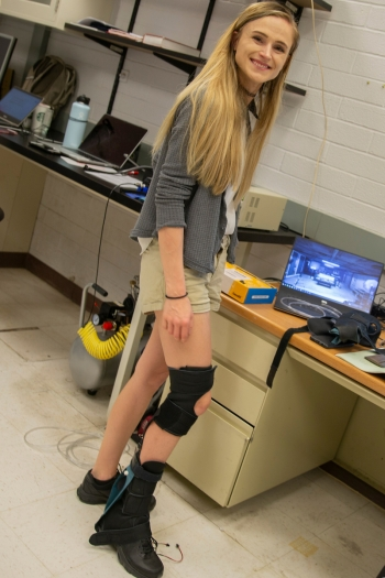 Carly Thalman wearing a soft robotic ankle-foot orthosis, or SR-AFO, exosuit