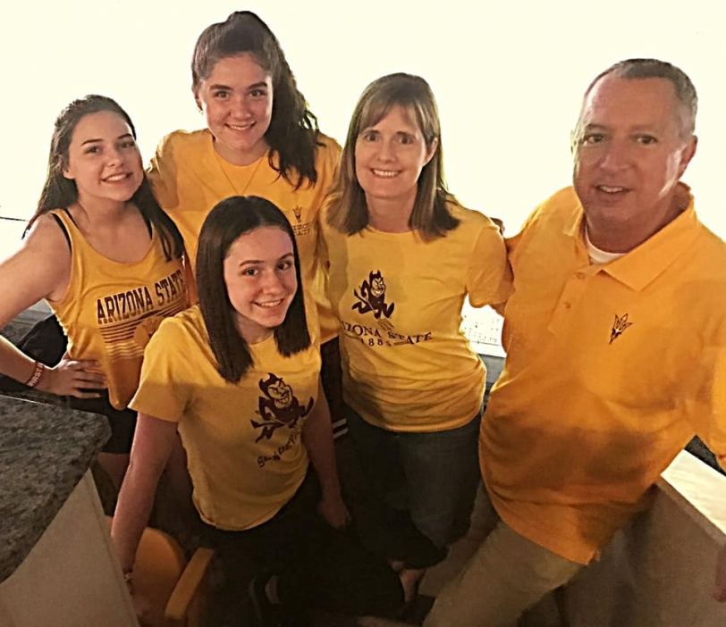 mother, father and their three daughters wearing ASU shirts