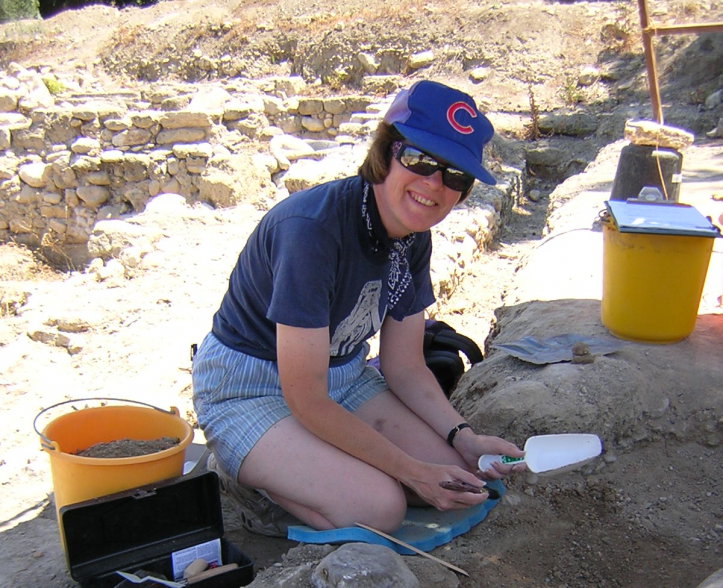 photo of Baker excavating at a field site