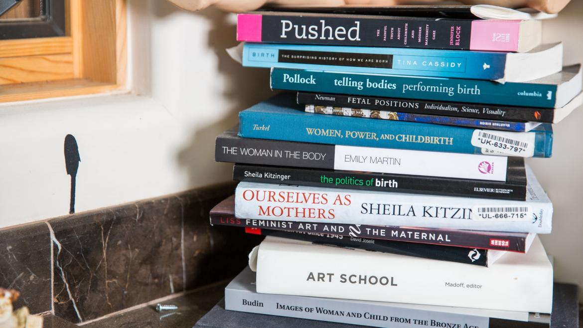 A stack of books on a shelf.