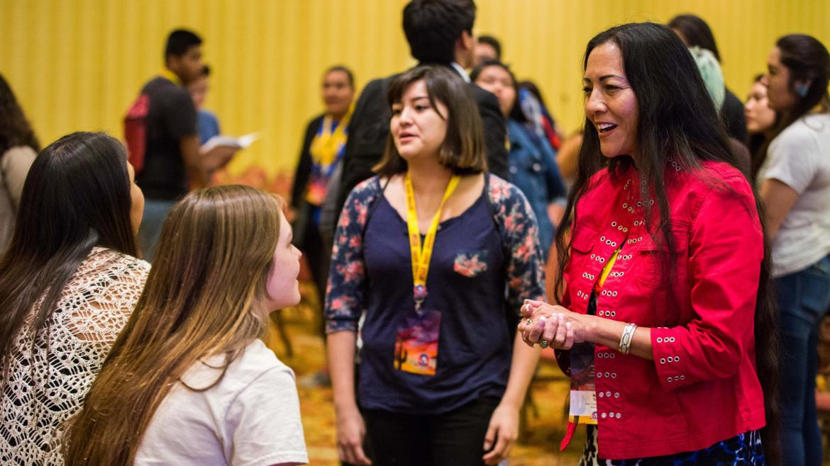 Mary Kim Titla speaks with students at a UNITY conference