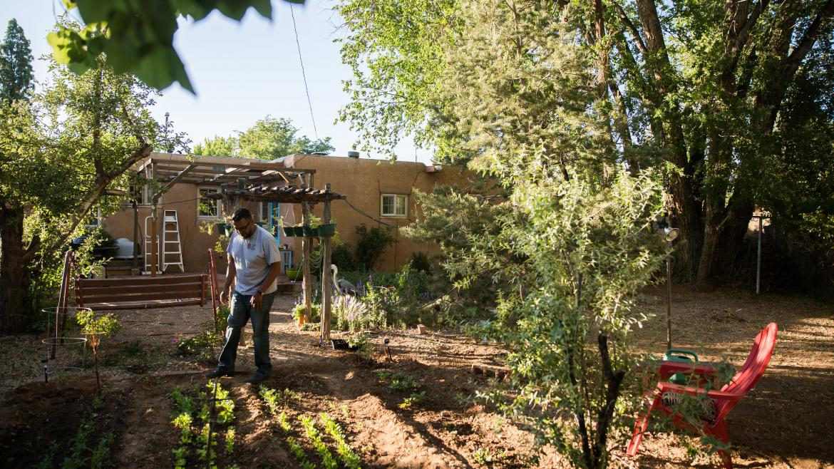 Carnell Chosa works in his garden in Santa Fe