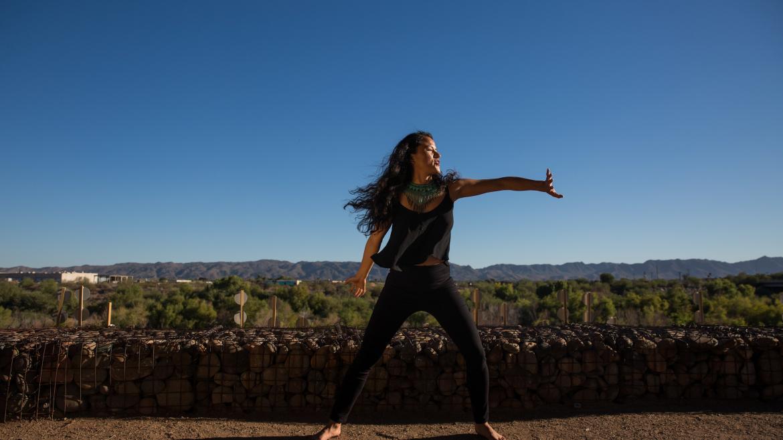 Artist Yadira De La Riva dances