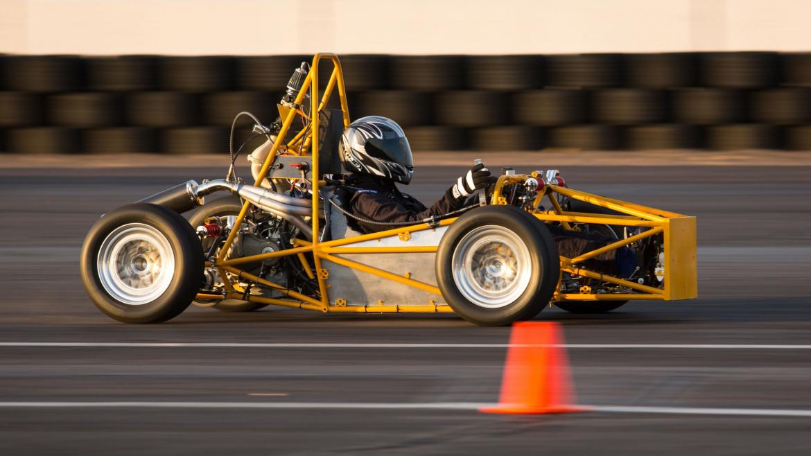 Students test drive their Formula SAE race car on the track.