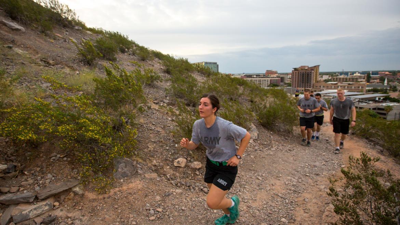 People running up mountain