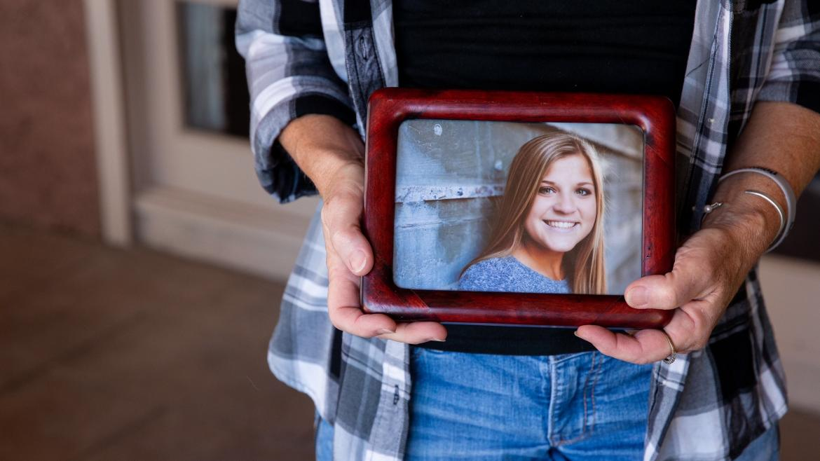 woman holding photo of daughter