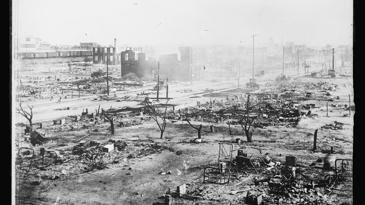 a historical photo of a town in ruins after fire