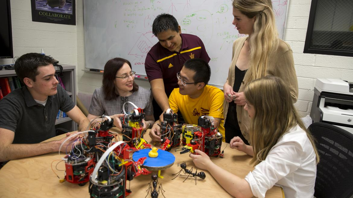 ASU engineer working with students on robots