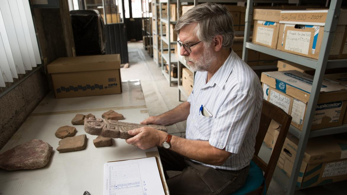 ASU professor Michael E. Smith looks at ancient objects in the Teotihuacan Research Laboratory in Mexico