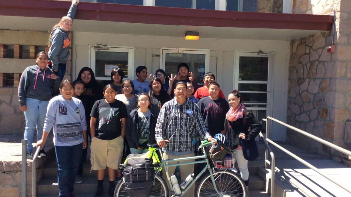 ASU master's student Kenny Dyer Redner with a class of Native students