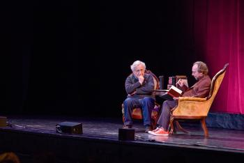Noam Chomsky and Lawrence Krauss seated on stage at ASU Gammage
