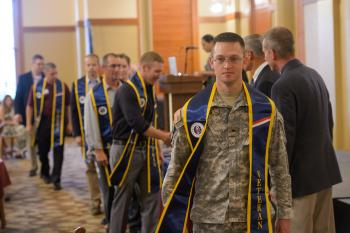 graduating ASU veteran students attending a reception