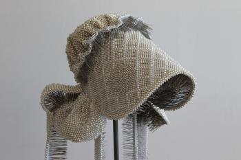Photo of Angela Ellsworth piece Seer Bonnet