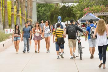 students walking on campus mall