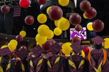 balloons dropping on students at graduation