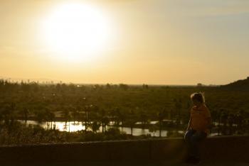 ASU student watching sunset