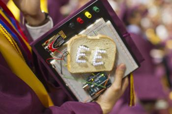An asu grad's mortarboard is decorated as a breadboard.