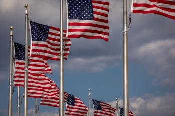 A circle of U.S. flags waving in the wind