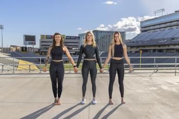 ASU Family yoga series instructors Pixi Pickthall, Randi Graves and Alexandra Vlachos stand on the deck overlooking Sun Devil Stadium