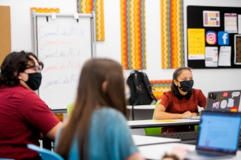 masked students in a socially distanced classroom