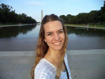 Alexis in front of the National Monument while studying in Washington, D.C.