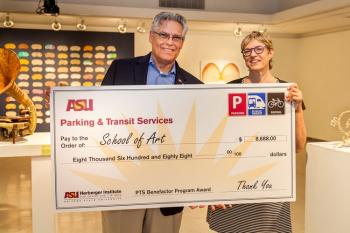 PTS associate director Ray Humbert presenting check to School of Art director Adriene Jenik.