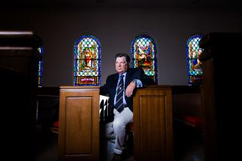 Instructor Charles Barfoot Sits in Church Pew