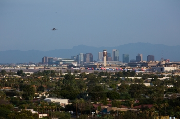 A view of the Phoenix downtown skyline as a plane takes off
