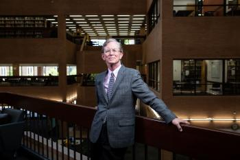 University Librarian Jim O'Donnell poses for a portrait on the second floor of Noble Library