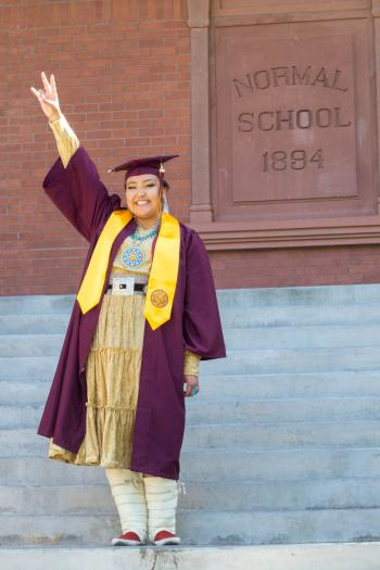 ASU graduate Christina Haswood poses outside Normal School