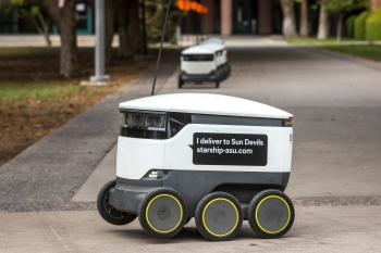 Food delivery robot on a sidewalk