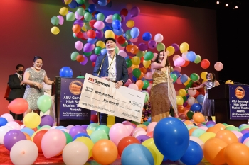 The Best Lead Male and Female winners of the 2021 ASU Gammage High School Musical Theatre Awards stand onstage surrounded by balloons.