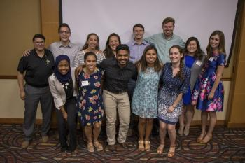 13 of the 17 Spring 2017 Grand Challenge Scholars pose for a group photo at the Grand Challenge Scholars Program Graduation Reception.