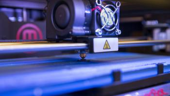 A 3D printer begins to print.