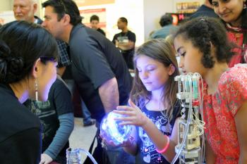 Young scholars examine research artifact at the Biodesign Institute at ASU at Night of the Open Door