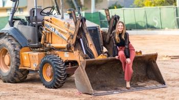 Tiffany Sharp poses with a bulldozer.