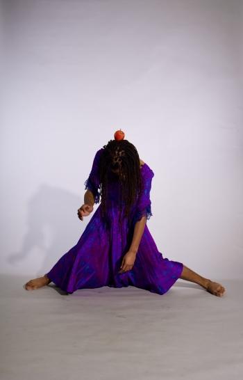 dancer with an apple on their head