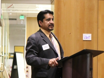 Executive Director of ASU's Pastor Center for Politics and Public Policy Alberto Olivas speaking at a lectern