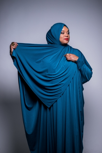Angelica Lindsey-Ali poses in blue garment and hijab