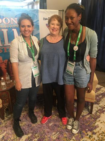 Anique Brito (left) poses with fellow student Trejon Dunkley (right) and a participant at the 2016 Sedona Film Festival.