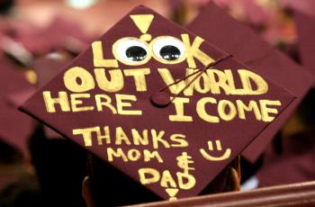 "Graduation cap that says ""Look out world here I come"""