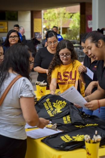 ASU students helping community members at Future Sun Devil Family Day