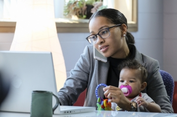 Graduate student works while caring for baby