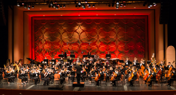 symphony playing music on a stage