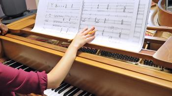 student composing music