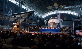 Members of the National Space Council are seen during the council's first meeting, Thursday, Oct. 5, 2017, at the Smithsonian National Air and Space Museum's Steven F. Udvar-Hazy Center in Chantilly, Va. The National Space Council, chaired by Vice Preside