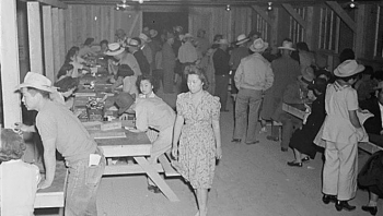 Photo shows people of Japanese decent registering upon arrival to an internment camp in Arizona.