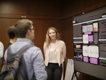 Psychology alumna and Dean's Medalist, Isabel Strouse, practices presenting her award-winning research in front of her peers. Photo: Robert Ewing