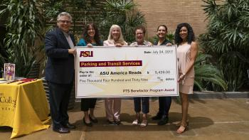 Parking and Transit Services present ASU America Reads with funds from the 2016-17 PTS Benefactor Program. From left: Ray Humbert, PTS associate director; Deborah Ruiz, community engagement programs director; Associate Dean Nancy Perry, Mary Lou Fulton Te